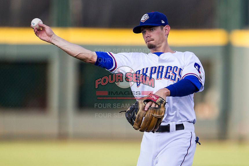 Round Rock Express second baseman Brent Lillibridge (16) makes a throw to first base during the second game of a Pacific Coast League doubleheader against the Memphis Redbirds on August 3, 2014 at the Dell Diamond in Round Rock, Texas. The Redbirds defeated the Express 7-6. (Andrew Woolley/Four Seam Images)