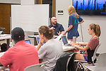 Brad Campbell, Director of the Writing Center, conducts a College Admissions Essay and Scholarship Writing workshop for rising high school juniors or seniors in the Writing Center in Lamar Hall.  Photo by Kevin Bain/Ole Miss Communications