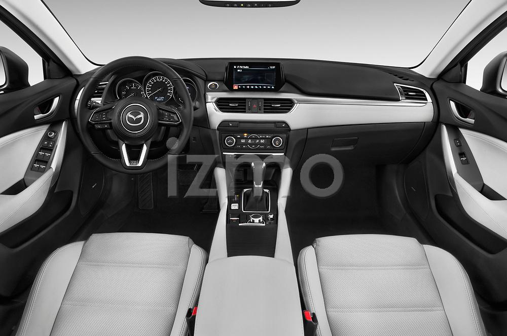 Stock photo of straight dashboard view of a 2017 Mazda Mazda6 Prestige Edition 4 Door Sedan