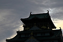"""May 21, 2012, Osaka, Japan - The partial solar eclipse is seen over the Osaka Castle in Osaka, western Japan on May 21, 2012. An annular solar eclipse was observed over a wide area of Japan on Monday early morning. Millions of people watched as a rare """"ring of fire"""" eclipse crossed the skies. (Photo by Akihiro Sugimoto/AFLO) -ty-"""