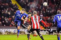 Cardiff City's defender Joe Bennett (3)  heads away under pressure during the Sky Bet Championship match between Sheff United and Cardiff City at Bramall Lane, Sheffield, England on 2 April 2018. Photo by Stephen Buckley / PRiME Media Images.