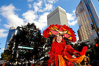 A costumed entertainer engages the crowds during the Wells Fargo Community Celebration, held October 29, 2011 in downtown Charlotte NC. The daylong festival took place in the streets, in public atriums and in downtown museums, which offered free admission all day long. Wells Fargo, which this month completed its conversion from Wachovia, picked up the bill.