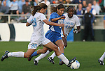1 December 2006: North Carolina's Tobin Heath (98) knocks the ball away from UCLA's Christine DiMartino (center) as Robyn Gayle (CAN) (11) trails the play. The University of North Carolina Tarheels defeated the University of California Los Angeles Bruins 2-0 at SAS Stadium in Cary, North Carolina in an NCAA Division I Women's College Cup semifinal game.