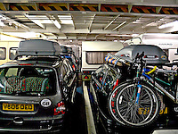 Vehicles driving and loaded onto the decks of the car ferry in such a way to distribute there weight evenly..©shoutpictures.com..john@shoutpictures.com