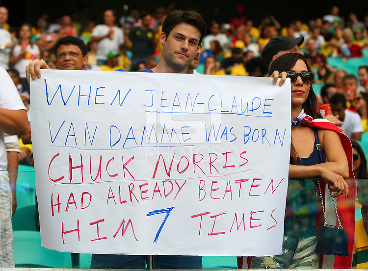 A USA supporter holds a banner saying Chuck Norris is better than Jean-Claude Van Damme