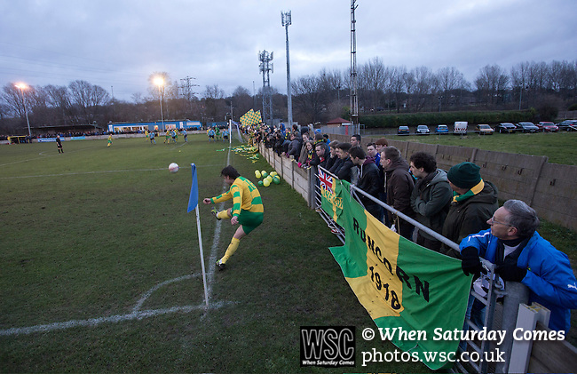 Runcorn Town 1 Runcorn Linnets 0, 26/12/2013. The Pavilions, North West Counties League Premier Division. Away supporters watching their team taking a corner during the first-half of the Boxing Day derby match between Runcorn Town and visitors Runcorn Linnets at the Pavilions, Runcorn, in a top-of the table North West Counties League premier division match. Runcorn Linnets won 1-0 and overtook their neighbours at the top of the league in a game watched by 803 spectators. Runcorn Linnets were a successor club to Runcorn FC, one of England foremost non-League clubs of the 1970s and 1980s. Photo by Colin McPherson.
