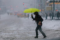 A woman makes her way under the snow during the pass of the winter storm JONAS, in New York, 01/23/2016. Photo by VIEWpress