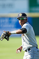 Miguel Andujar (5) of the Charleston RiverDogs warms up in the outfield prior to the game against the Hickory Crawdads at L.P. Frans Stadium on May 24, 2014 in Hickory, North Carolina.  The Crawdads defeated the RiverDogs 7-3.  (Brian Westerholt/Four Seam Images)