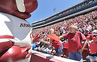 NWA Democrat-Gazette/Michael Woods --04/25/2015--w@NWAMICHAELW... Razorback fans Kaiden Carlton, age 12 and Kaleb Carlton, age 10, both from Omaha Arkansas, get a high five from Razorback mascot Boss Hog before the start of the 2015 Red-White game Saturday afternoon at Razorback Stadium in Fayetteville.