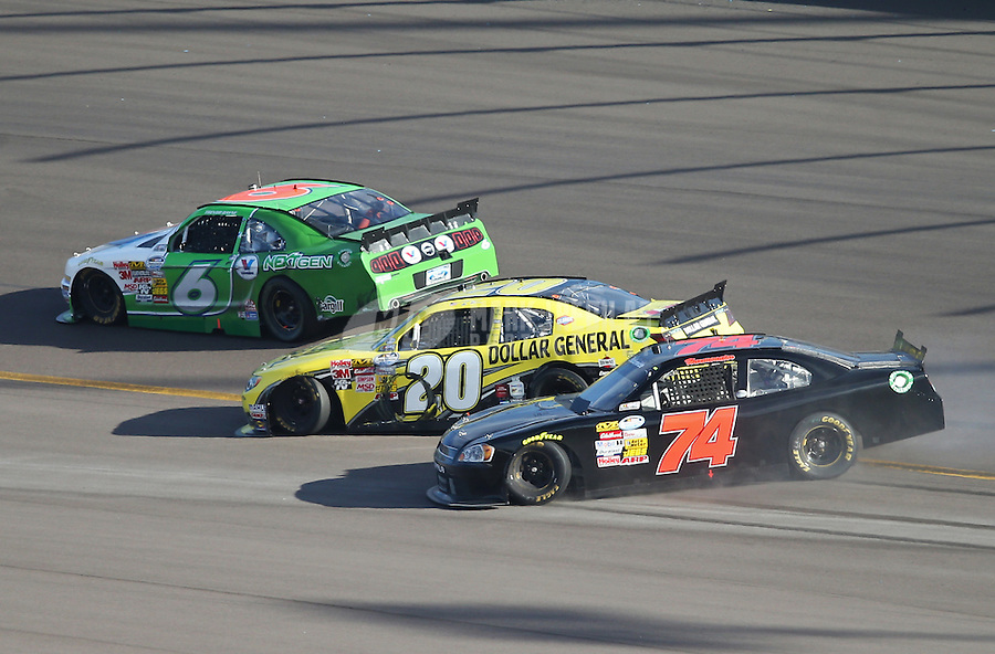 Mar. 2, 2013; Avondale, AZ, USA; NASCAR Nationwide Series drivers Brian Vickers (20) and Mike Harmon (74) spin as Trevor Bayne (6) goes high during the Dollar General 200 at Phoenix International Raceway. Mandatory Credit: Mark J. Rebilas-