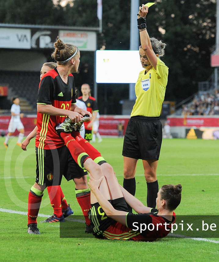 20170613 - LEUVEN ,  BELGIUM : Belgian Heleen Jaques (down) and Laura Deloose (L) with referee Ivana Martincic  pictured during the female soccer game between the Belgian Red Flames and Japan , a friendly game before the European Championship in The Netherlands 2017  , Tuesday 13 th Juin 2017 at Stadion Den Dreef  in Leuven , Belgium. PHOTO SPORTPIX.BE | DIRK VUYLSTEKE