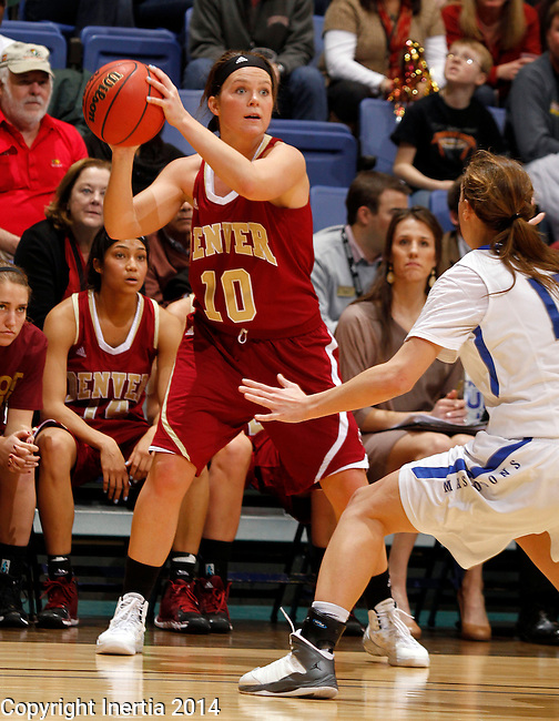 SIOUX FALLS, SD - MARCH 9:  Morgan Van Riper-Rose #10 from Denver  looks for a teammate past Amanda Hyde #11 from IPFW in the second half of their game Sunday afternoon at the 2014 Summit League Basketball Tournament in Sioux Falls, SD. (Photo by Dave Eggen/Inertia)