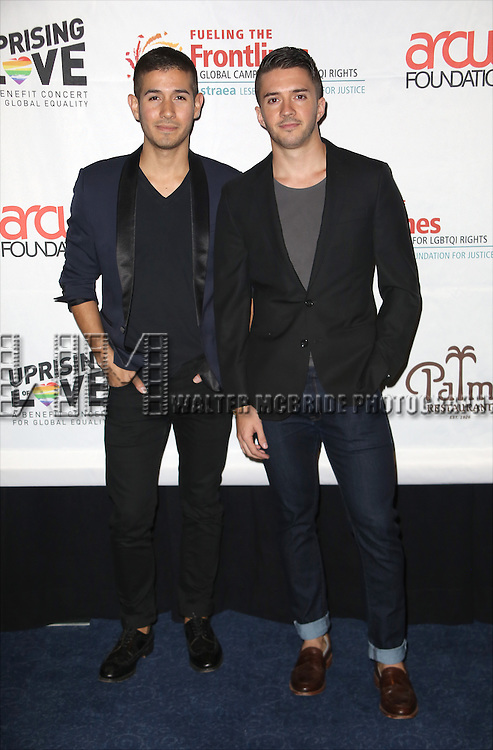 Saul Carrasco and Blake Skjellerup backstage at 'Uprising Of Love: A Benefit Concert For Global Equality' at the Gershwin Theatre on September 15, 2014 in New York City.