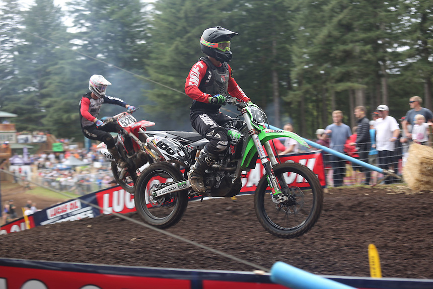 Riders are airborne after they blast up a hill in the 450cc race in the Washougal MX National in Washougal Saturday July 23, 2016. D(Photo by Natalie Behring/ for the The Columbian)