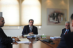Jihad Al Wazir, center, Governor of Palestine Monetary Authority, at his office in Al Beireh, West Bank.<br /> Photo by Ahikam Seri