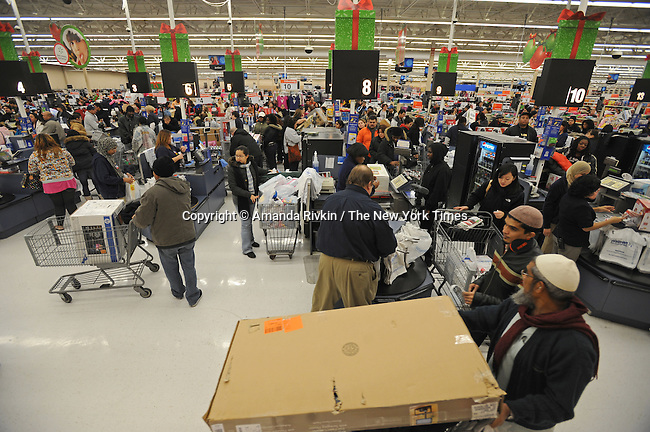 "Shoppers crowd a Wal-mart at 5 A.M. the day after Thanksgiving on the retail shopping spree day known as ""Black Friday"" in the northwest Chicago suburb of Niles, Illinois on November 28, 2008.  Despite the recession and economic downturn, shoppers still rose early and flocked to big ticket items like flat screen televisions, a popular item at the Wal-mart in Niles."