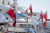 Principality of Monaco, on the French Riviera (Côte d'Azur), district La Condamine: luxury yachts in Port Hercule under Cayman Islands' flag | Fuerstentum Monaco, an der Côte d'Azur, Stadtteil La Condamine: Luxusyachten im Port Hercule unter der Flagge der Cayman Islands