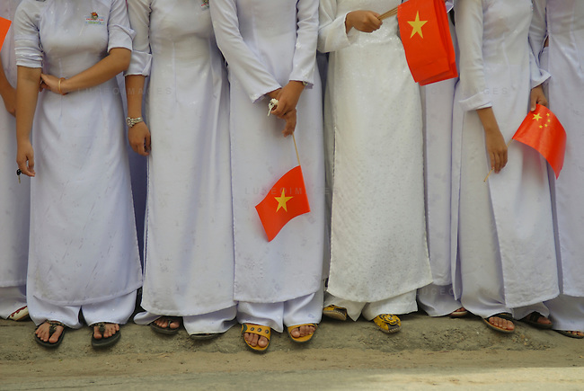 Vietnamese students at a parade in Hoi An, Vietnam.