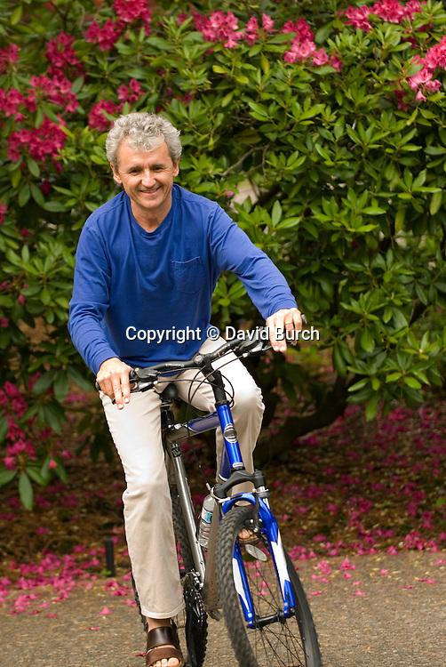 Mature man balancing on bicycle
