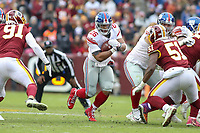 Landover, MD - December 9, 2018: New York Giants running back Saquon Barkley (26) runs the ball during the  game between New York Giants and Washington Redskins at FedEx Field in Landover, MD.   (Photo by Elliott Brown/Media Images International)