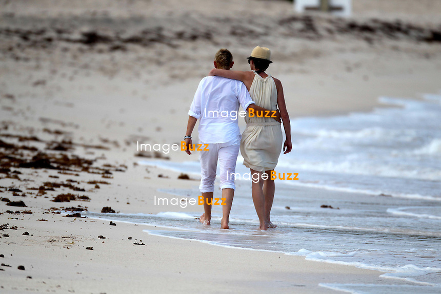 ELLEN DEGENERES & PORTIA DE ROSSI  IN ST. BARTHS  - Ellen  DeGeneres & Portia de Rossi spending some romantic Christmas vacation in Saint Barths. Following a lunch at the Eden Rock restaurant, the couple spent some romantic time on the beach. December 24, 2012.