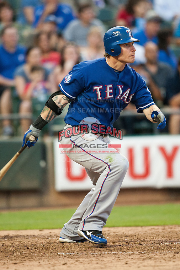 "Texas Rangers center fielder Josh Hamilton #32 leaves the batters box during the MLB exhibition baseball game against the ""AAA"" Round Rock Express on April 2, 2012 at the Dell Diamond in Round Rock, Texas. The Rangers out-slugged the Express 10-8. (Andrew Woolley / Four Seam Images)."