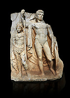 Roman Sebasteion relief  sculpture of emperor Tiberius with a captive Aphrodisias Museum, Aphrodisias, Turkey.   Against a black background.<br /> <br /> The naked emperor Tiberius stands frontally holding a spear and shield wearing a cloak and a sword strap. Besides him stands a barbarian