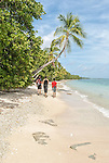 Travellers exploring the coastline on the northern point of Funafuti Atoll, Tuvalu