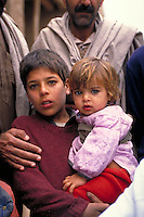 These children are just two of the thousands of Afghan refugees who fled to Pakistan during the war. child, victims of military aggression, violence, refugees, political conditions. Afghan refugee children. Peshawar, Pakistan Asia.