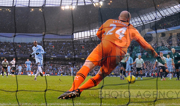 Mario Balotelli of Manchester City scoring the winning goal from the penalty spot.Barclays Premier League.Manchester City v Tottenham at the Eithad Stadium, Manchester 22nd January, 2012..Sportimage +44 7980659747.picturedesk@sportimage.co.uk.http://www.sportimage.co.uk/.Editorial use only. Maximum 45 images during a match. No video emulation or promotion as 'live'. No use in games, competitions, merchandise, betting or single club/player services. No use with unofficial audio, video, data, fixtures or club/league logos.