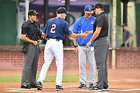 Home plate umpire Justin Juska, Elizabethton Twins manager Ray Smith (2), Kingsport Mets manager Sean Ratliff and first base umpire Thomas O'Neil great each other before a game between the Kingsport Mets and the Elizabethton Twins at Joe O'Brien Field on August 7, 2018 in Elizabethton, Tennessee. The Twins defeated the Mets 16-10. (Tony Farlow/Four Seam Images)