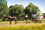 Amish man spraying field with herbicide