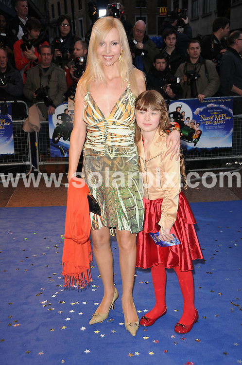 **ALL ROUND PICTURES FROM SOLARPIX.COM**.**WORLDWIDE SYNDICATION RIGHTS**.the UK premiere of Nanny McPhee And The Big Bang, .Odeon West End, Leicester Square, London, UK. 24 March 2010.This pic: Anneka Svenska and daughter..JOB REF: 10974 MSR    DATE: 24_03_2010.**MUST CREDIT SOLARPIX.COM OR DOUBLE FEE WILL BE CHARGED**.**MUST NOTIFY SOLARPIX OF ONLINE USAGE**.**CALL US ON: +34 952 811 768 or LOW RATE FROM UK 0844 617 7637**