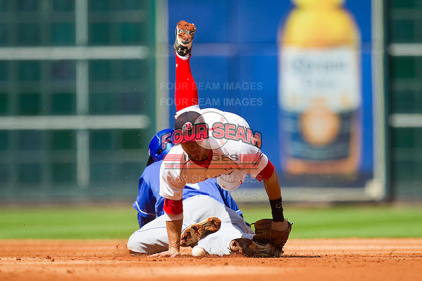 Second baseman Michael Beltran #8 of the Utah Utes can't handle the throw as Taylor Black #5 of the Kentucky Wildcats slides head first into second base at Minute Maid Park on March 6, 2011 in Houston, Texas.  Photo by Brian Westerholt / Four Seam Images