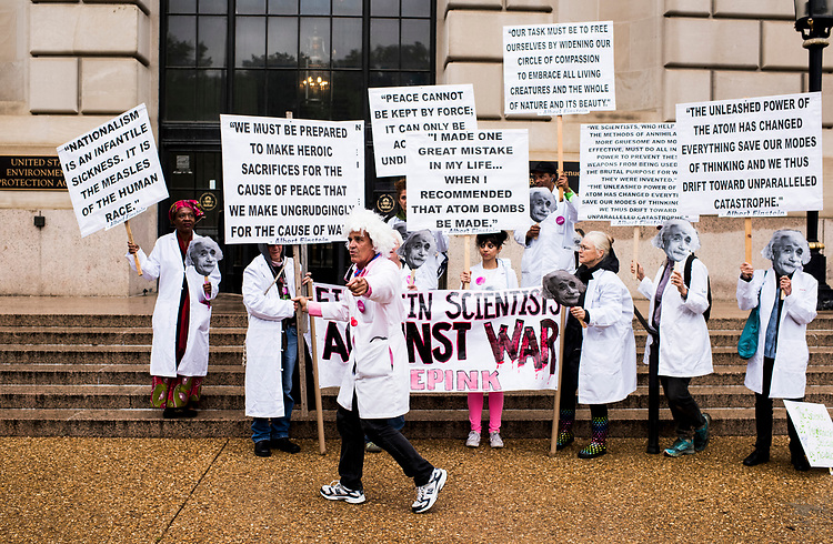 UNITED STATES - APRIL 22: CodePink protesters dressed as Albert Einstein rally in front of the Environmental Protection Agency before the start of the March for Science in Washington on Earth Day, Saturday, April 22, 2017. Thousands of pro-science and environmental activists rallied on the National Mall before marching towards the Capitol. (Photo By Bill Clark/CQ Roll Call)