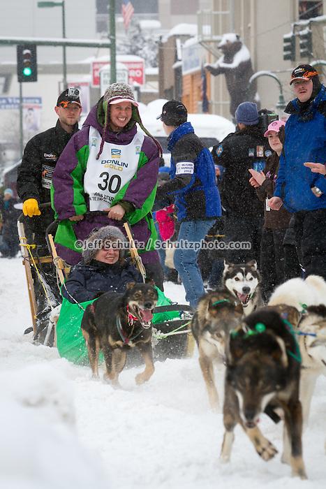 Jaimee Kinzer leaves the 2011 Iditarod ceremonial start line in downtown Anchorage, during the 2012 Iditarod..Jim R. Kohl/Iditarodphotos.com