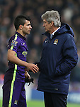 Manuel Pellegrini manager of Manchester City checks on Sergio Aguero of Manchester City as he comes off injured - Barclays Premier League - Stoke City vs Manchester City - Britannia Stadium - Stoke on Trent - England - 11th February 2015 - Picture Simon Bellis/Sportimage
