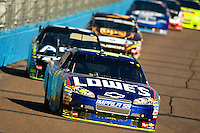 Coverage Jimmie Johnson, driver of the #48 Lowe's Chevrolet, races during the NASCAR Sprint Cup Series Checker O'Reilly Auto Parts 500 at Phoenix International Raceway on November 15, 2009 in Avondale, Arizona
