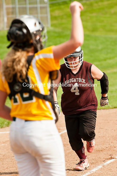 WATERBURY, CT-27 May 2014-052714EC04-  Naugatuck's Gillian Fortier heads home to score against Holy Cross. The Greyhounds defeated the Crusaders, 6-3, in the NVL softball quarterfinals Tuesday in Waterbury. Holy Cross' catcher is Paige Hine. Erin Covey Republican-American