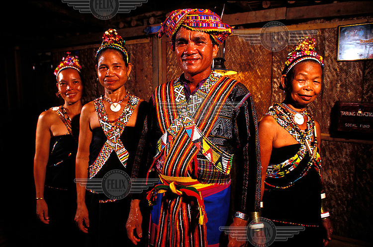 ©Chris Stowers/Panos Pictures..Tribes people in the remote village of Kampong Bavanggazo in northeast Sabah, East Malaysia, dressed in traditional finery at the completion of a dance to welcome visitors to their longhouse.