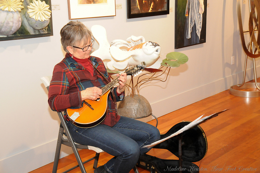 Musician Jeanne Hamilton plays her mandolin at the Rectangle Gallery.<br />
