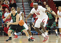 NWA Media/ J.T. Wampler -Arkansas' Bobby Portis steals the ball from Utah Valley's Eli Robinson Saturday Jan. 3, 2015 at Bud Walton Arena in Fayetteville. The Hogs won 79-46.