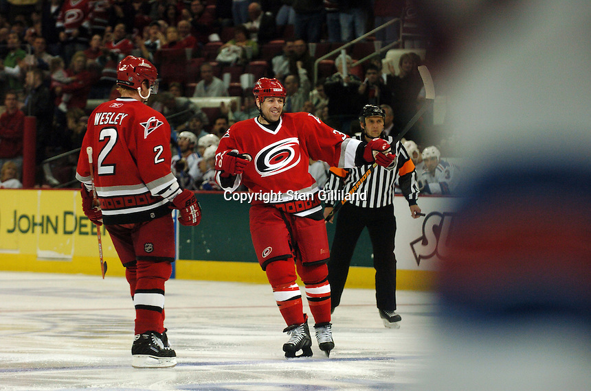 Carolina Hurricanes' Doug Weight celebrates the first of his two goals against the New York Rangers Tuesday, March 14, 2006 at the RBC Center in Raleigh, NC. Teammate Glen Wesley (2) is seen at left. Carolina won 5-3.