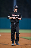 Brendan McKay (38) of the Louisville Cardinals walks off teh field between innings of the game against the North Carolina State Wolfpack at Doak Field at Dail Park on March 24, 2017 in Raleigh, North Carolina.  (Brian Westerholt/Four Seam Images)
