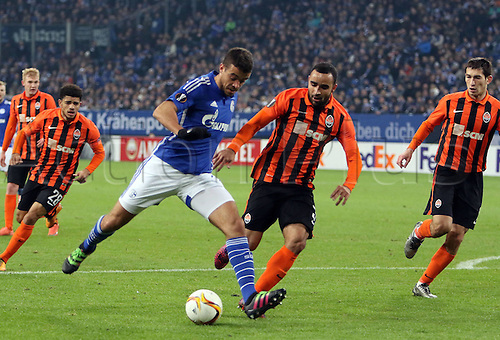 25.02.2016. Gelsenkirchen, Germany. Europa League Round of 32 Second Leg soccer match between Schalke 04 and FC Shakhtar Donetsk in the Veltins Arena in Gelsenkirchen, Germany. Junior Caicara (FC Schalke 04) chased down by Ismaily (Donetsk)