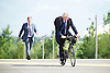 Boris Johnson <br /> Mayor of London <br /> at The Queen Elizabeth Olympic Park, Mandeville Place,  Stratford, London, Great Britain <br /> 26th May 2015 <br /> <br /> opening new Olympic Park Orchard to mark London Tree Week <br /> <br /> being chased by one of the guys from his press team <br /> <br /> <br /> <br /> Photograph by Elliott Franks <br /> Image licensed to Elliott Franks Photography Services