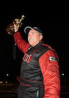 Nov 14, 2010; Pomona, CA, USA; NHRA top alcohol funny car driver Mickey Ferro celebrates after winning the Auto Club Finals at Auto Club Raceway at Pomona. Mandatory Credit: Mark J. Rebilas-