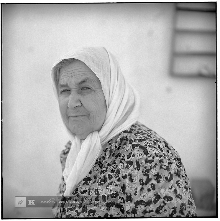 July 1996 -- Mykonos, Greek Islands -- An old Greek villager poses for the camera. .Andrew Kaufman©1996