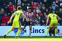 Lincoln City's Bruno Andrade looks to get past Cheltenham Town's Charlie Raglan, left, and Sean Long<br /> <br /> Photographer Andrew Vaughan/CameraSport<br /> <br /> The EFL Sky Bet League Two - Lincoln City v Cheltenham Town - Saturday 13th April 2019 - Sincil Bank - Lincoln<br /> <br /> World Copyright &copy; 2019 CameraSport. All rights reserved. 43 Linden Ave. Countesthorpe. Leicester. England. LE8 5PG - Tel: +44 (0) 116 277 4147 - admin@camerasport.com - www.camerasport.com
