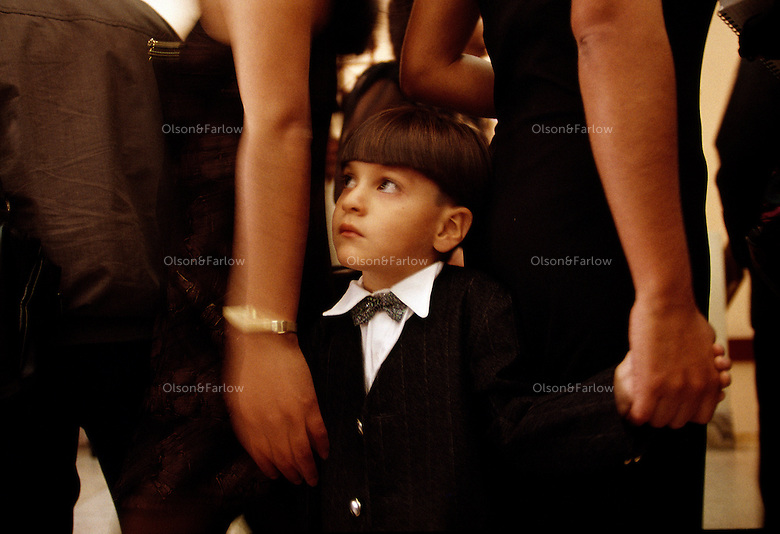 A young boy patiently waits for cake at a wedding reception at Iglesia Virgen de Fatima in Miraflores, a suburb of Lima.